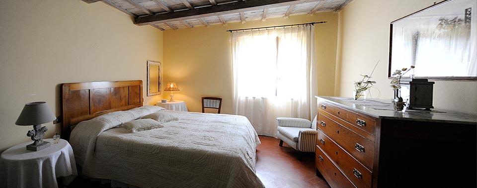 ...riposare in camere con vista sulla Toscana